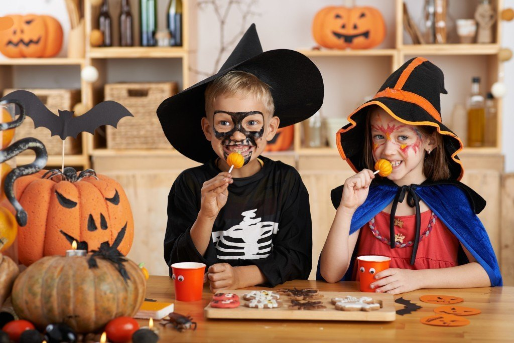 Children eating Halloween treats at the party