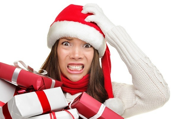 Christmas stress - busy woman wearing santa hat stressing for ch