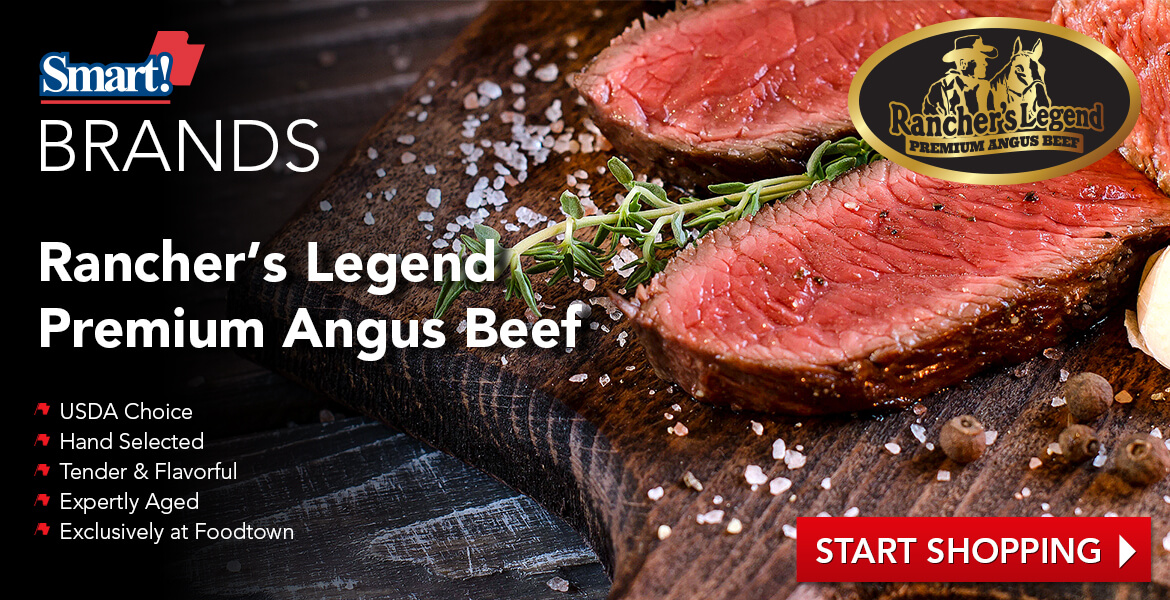 Piece of steak on cutting board advertising Rancher's Legend brand meat