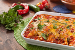 tray of turkey enchiladas in baking dish on table