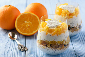 a creamsicle chia parfait with sliced oranges