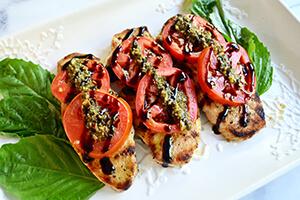 pesto tomato chicken on a plate