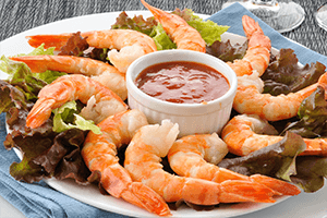 Shrimp cocktail on a plate with cocktail sauce