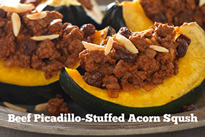 Beef Picadillo stuffed acorn squash on a plate