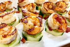 shrimp avocado cucumber bites on a plate