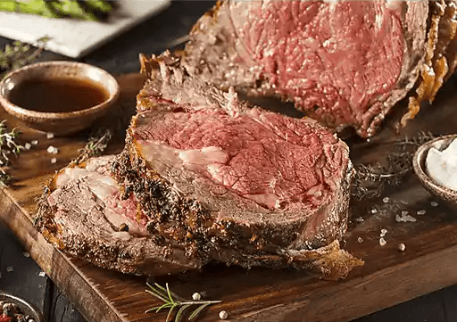 Peppered Rib Eye Roast With Roasted Garlic Sauce Crop