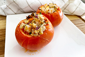 white bean and shrimp stuffed tomatoes on a plate