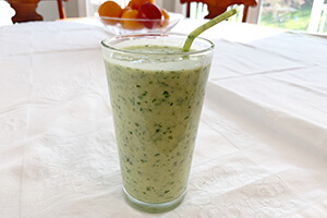 a creamy pineapple smoothie in a glass on the table