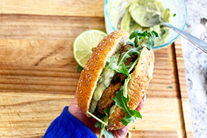 a veggie burger made with arugula and guacamole