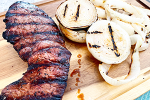 Grilled London Broil on a cutting board