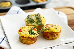 3 egg muffins on a plate for breakfast